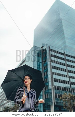 Happy Business Woman Outdoors With Umbrella