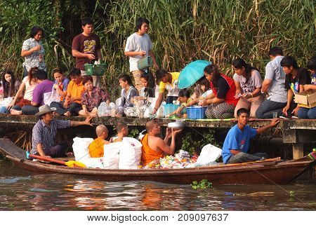 BANGKOK THAILAND - OCTOBER 8 2017 : Tuk baat Phra Roi River Festival (Give alms to a Buddhist monk on boat) On the Lamplatiew Canal in front of Wat Sutthaphot Lat Krabang District Bangkok