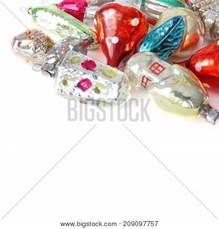 bright christmas balls and toys on white background