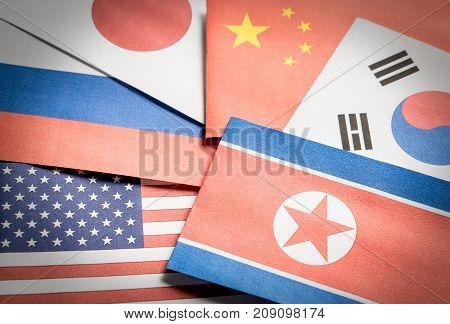 The flag of North Korea, South Korea, United Stated of America (USA), Russia, Japan and China made from paper.