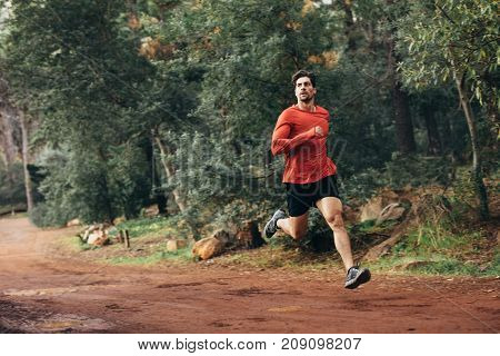 Man Running In A Park