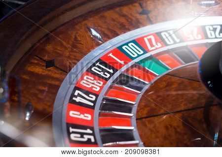Roulette in casino with shiny light. Gambling concept.