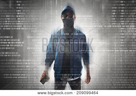 Unknown hacker holding mobile phone on binary code background