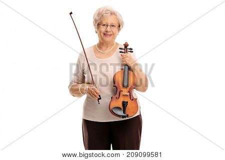 Mature woman with a wand and a violin isolated on white background