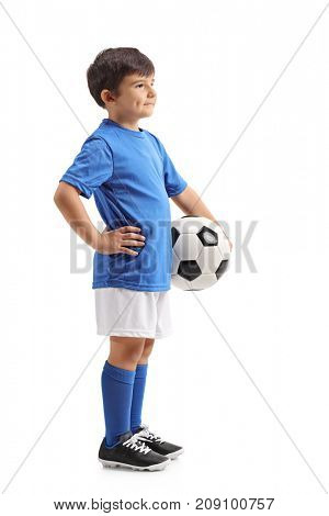 Full length profile shot of a little soccer player with a football waiting in line isolated on white background