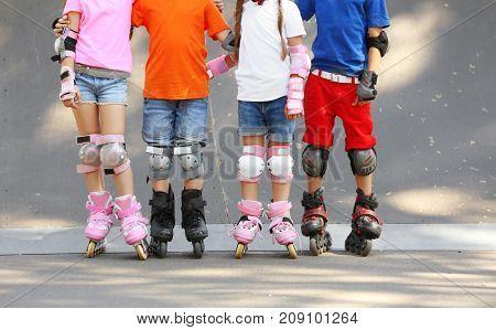 Cute children on rollers in skate park