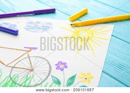Child's drawing of bicycle on table, closeup
