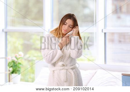 Young woman in morning at home