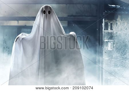 Mysterious ghost on haunted house at night
