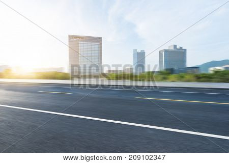empty road with modern buildings on background,shanghai,china.