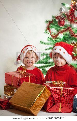 happy boy with christmas gift near Christmas tree