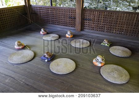 Kyoto, Japan - May 19, 2017: Room with traditional zen buddhist wooden fish gongs, Mokugyo and pillows to perform meditation