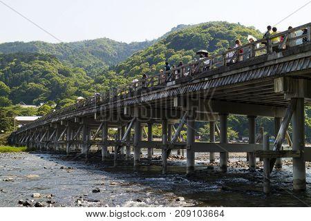 Kyoto, Japan - May 20, 2017:  Historical Togetsukyo Bridge over the Katsura River at Otsuki, Yamanashi, Japan