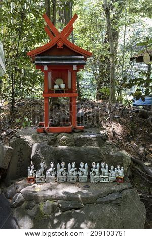 Kyoto, Japan - May 20, 2017: Traditional Kitsune, animal guardian in front of an Inari Shrine in Kyoto