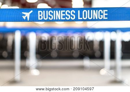 Business lounge at airport. Vip waiting area at terminal with seats in a row. Airport waiting room at terminal. Empty bench at gate.