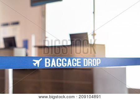 Baggage drop at airport. Luggage desk in terminal.
