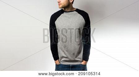 the guy in the blank grey black sweatshirt stand smiling on a white background mock up free space logo design template for design print