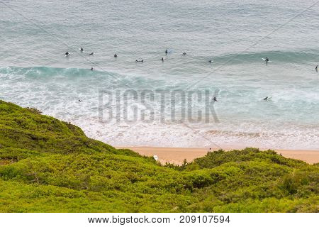 Surfers In Beliche Beach In Sagres