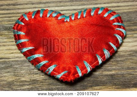 Red love heart fabric on wooden background