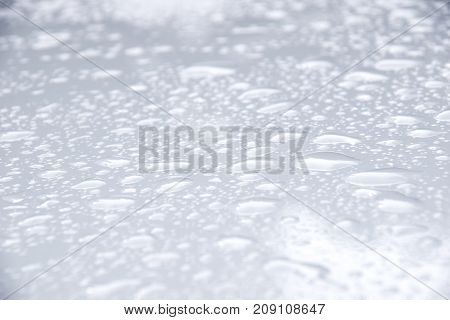 Close up Drop water on white floor background