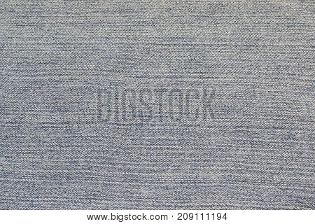 The blue jeans texture. Background of light blue jeans material