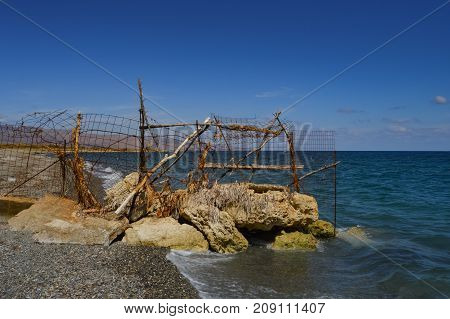 Rusty grating blocking access to a part of Maleme beach in Crete