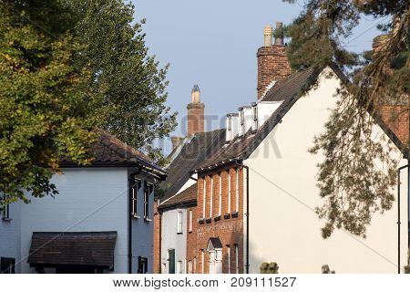 Quaint old English village street houses. Typical old British town houses in Wymondham Norfolk England. Picturesque village scene.