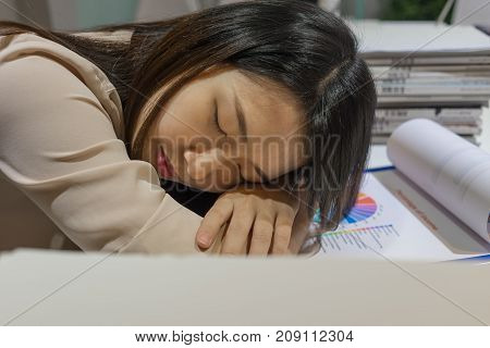 Young Asian businesswoman sleeping at the office