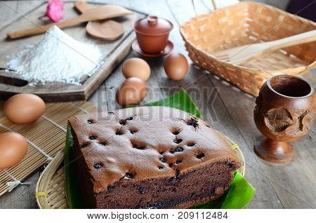 Taiwanese chocolate sponge cake with banana leaf on wooden board