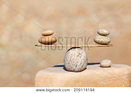 Symbolic scales of stones . Concept of harmony and balance. Pros and cons work - life concept. Soft focus selective focus