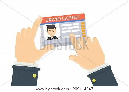 Man's driver license. Male hands holding plastic id card.
