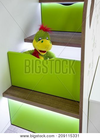Children's furniture. Stairs with drawers and LED lights in the bed.