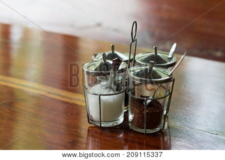 Thai style Seasoning fish sauce sugar vinegar and chilli powder in glasses for condiment set in local restaurant