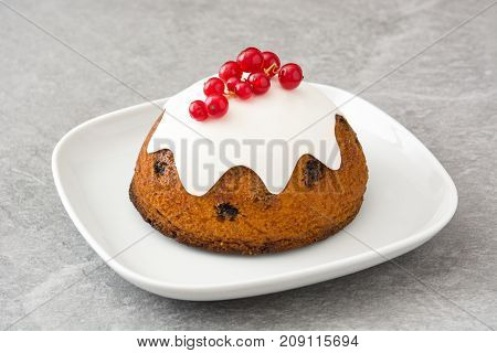 Christmas pudding on gray stone. Typical christmas cake
