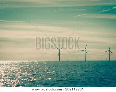 Wind Turbines Power Generator Farm Along Coast Sea
