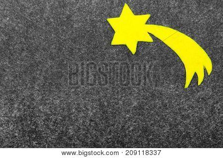 Star of Bethlehem on grey background. Felt Christmas ornaments with copy space