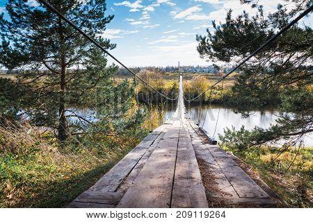 Bridge Over The River And The Autumn Nature Around