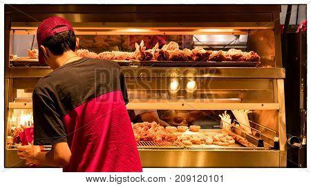 Minimum Wage Employee at a Fast food Restarant Kitchen