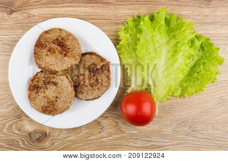 Fried Cutlets In White Plate, Leaves Of Lettuce And Tomato
