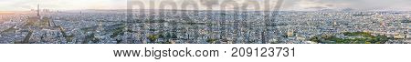 Panoramic aerilal view of whole Paris from Eiffel tower to Notre Dame cathedral at sunset. Copy space in sky.