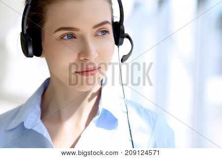 Portrait of beautifull business woman in headset. Call center operator.
