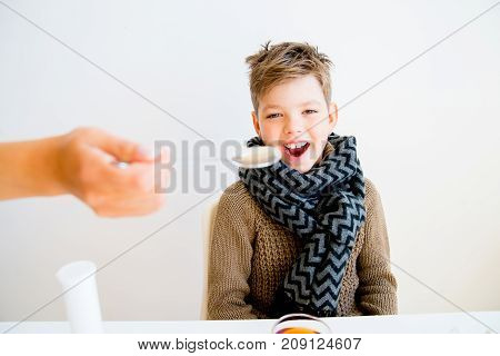 A portrait of a sick boy having flu