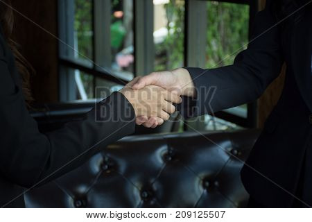 Closeup of a business woman shaking hands, Cooperation concept
