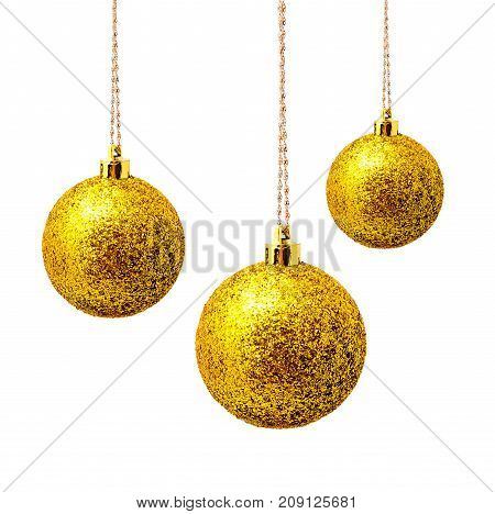 Hunging yellow christmas balls isolated on a white background