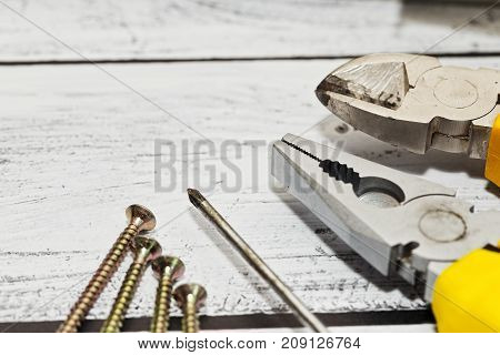 Some Hand Tools On Wooden Background