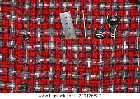 Wrenches And Ruler In Work Shirt Pocket