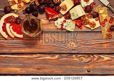 Assortment Of Cheese On Wooden Background