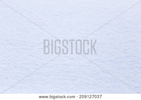 background of white fluffy snow . Photo of abstract background