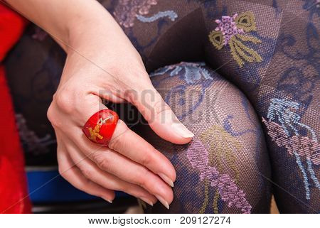 Woman's Legs With Beautiful Stockings And Hand With Red Ring