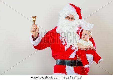 Man Wearing Santa Claus Costume Holding Baby